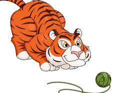 Тигр играет с клубком.
